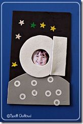 """I saw this awesome letter """"a"""" astronaut craft at Creativity Abounds. We changed it a little to go along with the book. We added foil stars in the sky and used hole reinforcement stickers to be the craters on the moon."""