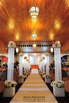 church wedding aisle designed by Celebrations in Grand Cayman, featuring white hydrangeas and pink roses