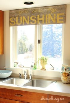I love this idea of using a painted barn wood sign as a window treatment yes yes yes this looks just like my kitchen