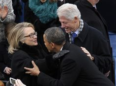 President Barack Obama is greeted by Secretary of State Hillary Clinton and former President Bill Clinton for his ceremonial swearing-in at the U.S. Capitol during the 57th Presidential Inauguration in Washington, Monday, Jan. 21, 2013.