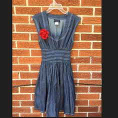 Cute Jean dress Perfect white stitching on thin blue jean like material. Red flower pin sold separately. Venus Dresses
