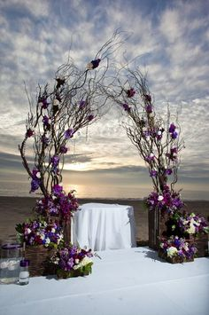 decor natural branches with wood bases and purple accents orlando wedding flowers / www.weddingsbycarlyanes.com