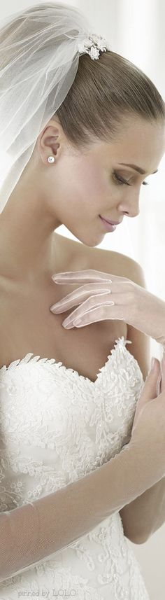Pronovias 2015 Dream Bridal Collection so feminine and beautiful no more messy hair for brides she looks amazing