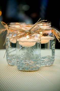 Floating candles in mason jars only with pebbles in the bottom!