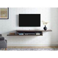 Float the Martin Furniture 72 in. Asymmetrical Wall Mounted TV Shelf below your wall-mounted television for convenient storage of your television component. Wall Mounted Tv Console, Wall Mount Tv Shelf, Wall Mount Tv Stand, Mounting Tv On Wall, Mounted Tv Decor, Martin Furniture, Tv Furniture, Cheap Furniture, Montage Tv