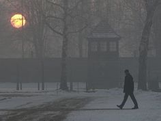 A man visits Auschwitz-Birkenau at sunrise, Jan. 27.