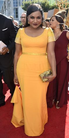 Mindy Kaling - Emmys 2015 Red Carpet Arrivals - yellow gown with an Edie Parker clutch - from InStyle.com