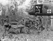American troops from the 73rd Airborne Brigade carrying a wounded soldier onto a helicopter near Vung Tau in Vietnam