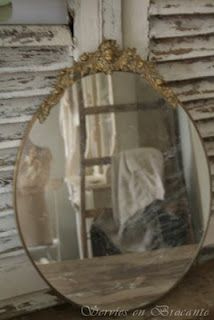 Nothing prettier than a gold, oval, antique mirror!