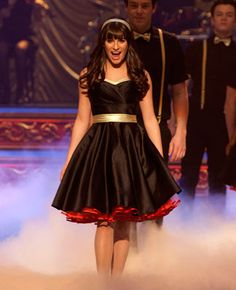 "#Glee: #LeaMichele's Season 3 style -- ""This dress was purchased from Unique Vintage, a retro store that redoes vintage patterns. It was all black and we added the gold trim and belt. Show choir always needs a color theme that matches to the song and in this case the director wanted a Moulin Rouge-inspired black and we added the gold trim and belt."""