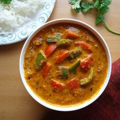 Flavorful curry of bell peppers with peanuts and sesame seeds - goes well with Indian flat breads and rice.