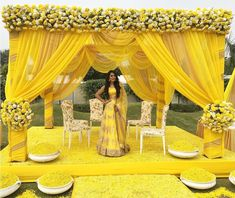 Simple and lively decoration ideas for haldi ceremony, to make it more fun packed. Wedding Ceremony Ideas, Desi Wedding Decor, Wedding Hall Decorations, Haldi Ceremony, Marriage Decoration, Wedding Mandap, Wedding Centerpieces, Outdoor Ceremony, Ceremony Backdrop