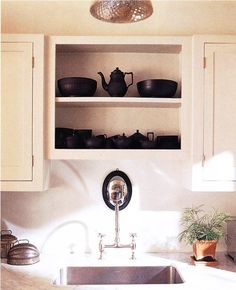 Maybe just one little set of open shelves in my kitchen to show my favorite dishes?