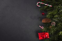 Fir twigs near candy canes and gift box Christmas Banners, Christmas Mood, Merry Christmas And Happy New Year, Christmas Background, Christmas Countdown, Xmas, Christmas Ornaments, Holiday, New Year Background Images