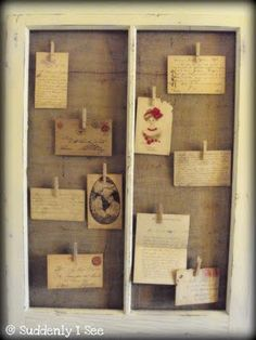My vintage window frame makeover, now displaying vintage post cards and letters. LOVE.