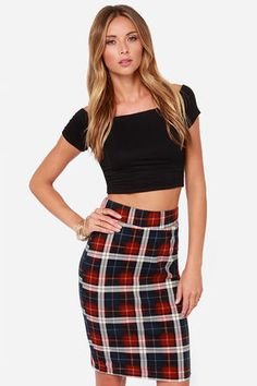 "The JOA Clash of the Tartans Plaid Midi Skirt has a rad plaid style of mythical proportions! This midi-length stretch-knit skirt is covered in a colorful plaid pattern of navy blue, wine red, and white with subtle lines of yellow. Its thick elastic waistline gives this skirt a nice and snug fit, with a modest midi length, and a high-waisted fit. Fully lined. Model is 5'9"" and wearing a size X-small. 65% Cotton, 35% Polyester. Polyester Lining. Dry Clean Only. Imported."