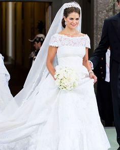 "Princess Madeleine of Sweden in Valentino.  The designer came out of retirement to design the princess's wedding gown.  He created a dress made with silk organdies and ivory Chantilly lace with a train that measured four meters long and a veil that measured six. ""(Princess Madeleine) is a very lovely girl.   She is modern, fun, full of energy and enthusiasm, and she is so beautiful! It has been a pleasure and an honor,"" he said in a statement."