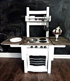play kitchen out of a chair! What a fun idea instead of the entertainment center that is so popular now.
