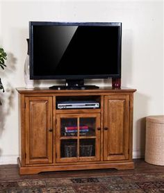 A Sunny Designs Sedona 64 in. TV Console will be a functional statement piece in your living room. Crafted from solid birch wood and durable MDF,. Entertainment Wall Units, Living Room Wall Units, Cool Tv Stands, Rustic Design, Adjustable Shelving, Entertaining, Birch, Home Decor, Benchcraft Furniture
