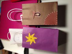 Treat bags (girl-sun, boy-Flynn Rider's satchel)