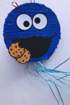 Partido de COOKIE MONSTER PINATA Sesame Street tire de