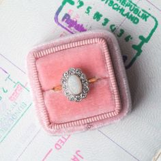 Victorian Era Engagement Ring with Dreamy Opal Center and Diamond Halo   Shady Lane from Trumpet & Horn