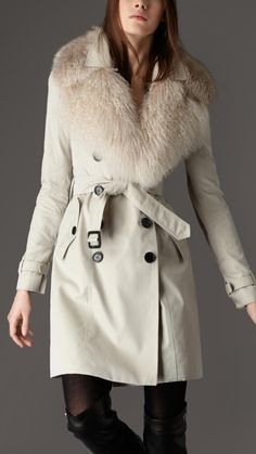 Burberry London Women's Trench Coat with Fox fur Over-collar, Double breasted Cotton Trench Coat with Fur over collar Trademark leather buckles, buttons, engraved with the Burberry logo Soft fox fur around the neck and curly shearling at the edges, Back rain shield, central back vent, Epaulettes, belted waist and cuffs Two front buttoned pockets