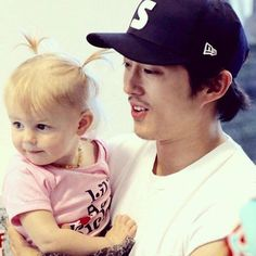 "STEVEN YEUN AND LIL ACTRESS THAT PLAYS  ""JUDITH GRIMES"""