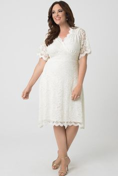 Get hitched in our plus size Graced With Love Wedding Dress. This retro-inspired wedding dress will make you feel beautiful on your big day. A detachable sash can be worn for a different kind of fit. Made exclusively for women's plus sizes. Shop our entire bridal collection at www.kiyonna.com