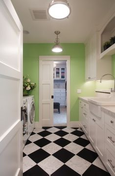 Clean & fresh looking laundry room with lots of storage. I like it. A lot.