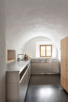 The kitchen of Baumhauer Architects' Florins Residence in Switzerland.
