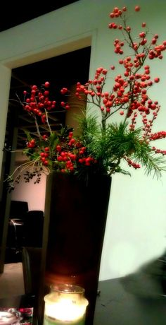 DIY Holiday Decor in the office -  One branch of red #berries and few #branches of forever green #leaves and use a brown (dark color) #vase. You all set for a nice #presentation for the #holidays!     #Christmas #DIY #Decor