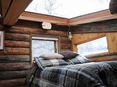 Love the large sky light in this cabin bedroom!