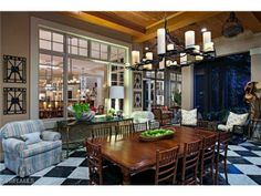 Lanai and outdoor dining room with black and white harlequin floor | 1st Ave North | Olde Naples, Florida