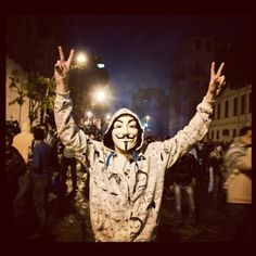 A protester wears a Guy Fawkes mask during the unrest in Cairo on Thursday, February 2. Thousands of protesters marched on government buildings after more than 70 soccer fans were killed in Port Said. Nearly 1,500 people were hurt in the Cairo confrontation, according to Egypt's Ministry of Health. Photo courtesy of @mosaaberizing.