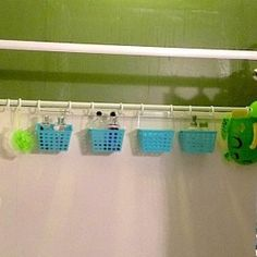 Add a tension shower rod to the back wall of the shower for baskets-to put all the stuff in!