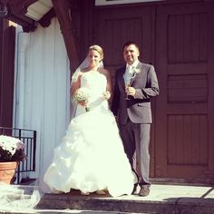 Me and my handsome husband on our weddingday! My beautiful ivory weddingdress peach and white weddingbouqet