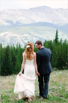 Stunning bride and groom portrait backdrop in Colorado. Venue: Ten Mile Station ---> http://www.weddingchicks.com/2014/05/29/rain-and-shine-rustic-colorado-wedding/