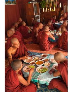 Southeast Asia  Monks sharing a meal in Mandalay. Credit: DIANA MAYFIELD: LONELY PLANET IMAGES