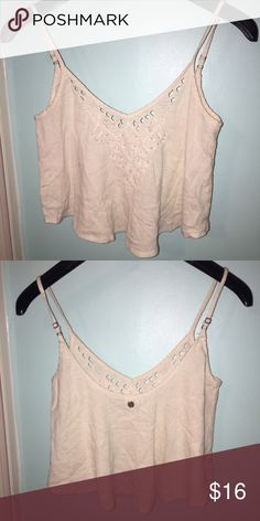 Billabong Tank Cream colored Billabong tank top with cut outs in the front, super cute, great for any occasion💫💕 Billabong Tops Tank Tops