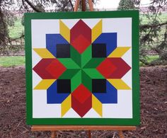 2' x 2' Barn quilt - Bold colors! Carpenter's wheel