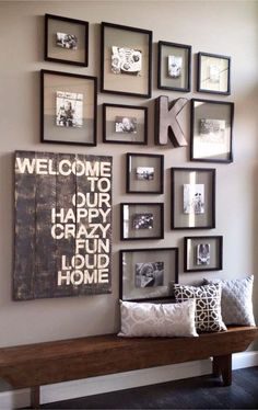 Using all the same frames on your gallery wall can give it a neat and organized look. LOVE that rustic / pallet bench too! Gallery wall ideas for your foyer.
