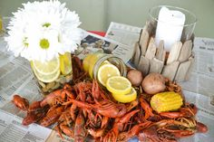 candles in glass, white  daisies with lemon slices  Wedding party crawfish boil :)