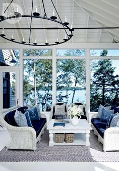 Coastal design, modern furnishings, wood furniture textured seating, blue accents, chandelier lighting