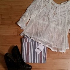 """Free People Striped Cropped Pants These pants are NWT! The colors are a dark grey/black, white and red. They have a banded waist with a zip closure on the left side. The size 2's are approximately 15"""" across the waist when laid flat, and 37"""" long with a 26"""" inseam. The size 0's are approximately 14"""" across the waist when laid flat and and 36"""" long with a 25"""" inseam. They are 55% linen, 42% cotton, 3% spandex. Please Note:  The pants modeled are a size 0. Free People Pants Ankle & Cropped"""