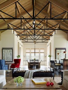 Amazing high, exposed ceilings with black metal-and-wood trusses used to hold the roof up and scaffolding for ceiling fans | Jennifer Robin Interiors
