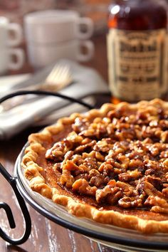 Bourbon Pumpkin Pie with Walnuts. Pin this dessert recipe for your next holiday dinner.