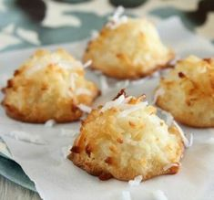 Ina's Coconut Macaroons: This recipe comes from one of my many Barefoot Contessa cookbooks. Ive tried many coconut macaroon recipes and this one is by far the best. For an extra special treat I have been known to dip the bottoms in bittersweet chocolate. Köstliche Desserts, Delicious Desserts, Dessert Recipes, Yummy Food, Top Recipes, Easy Recipes, Passover Desserts, Passover Recipes, Disney Recipes