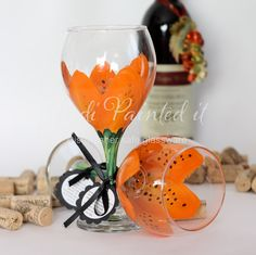 orange tiger lilly hand painted wine glasses  Do you like these at all or something along these lines? I could totally get them made as a gift for you and you could use them as your glasses for the wedding. Only of you wanted them!