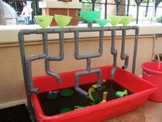 Our outdoor water play. Idea for a water sensory tub